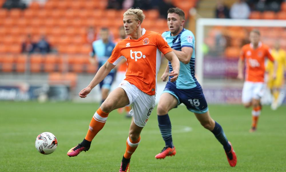 Blackpool's Brad Potts and Wycombe's Dan Rowe in action at a sparsely-populated Bloomfield Road.