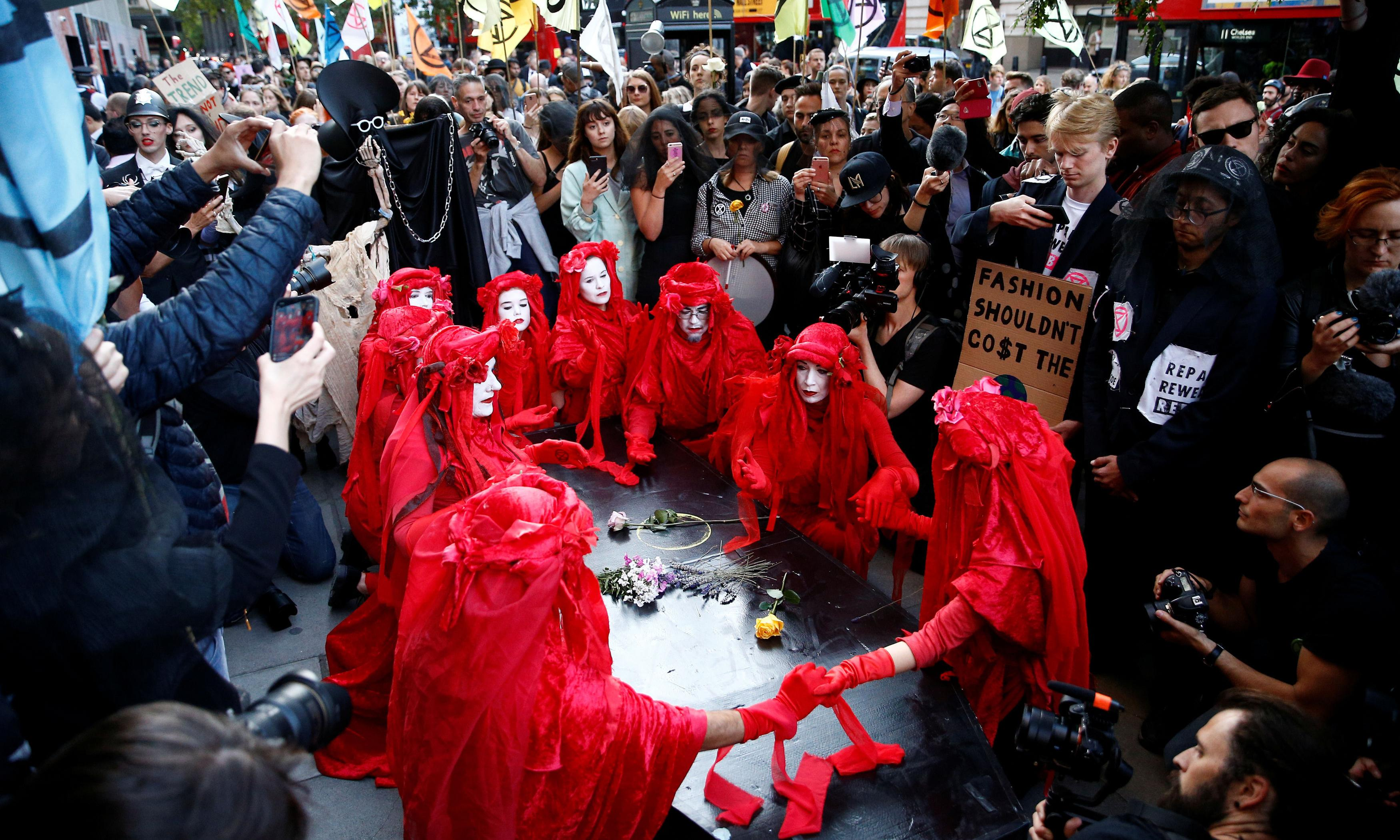 Extinction Rebellion stage funeral at London fashion week finale