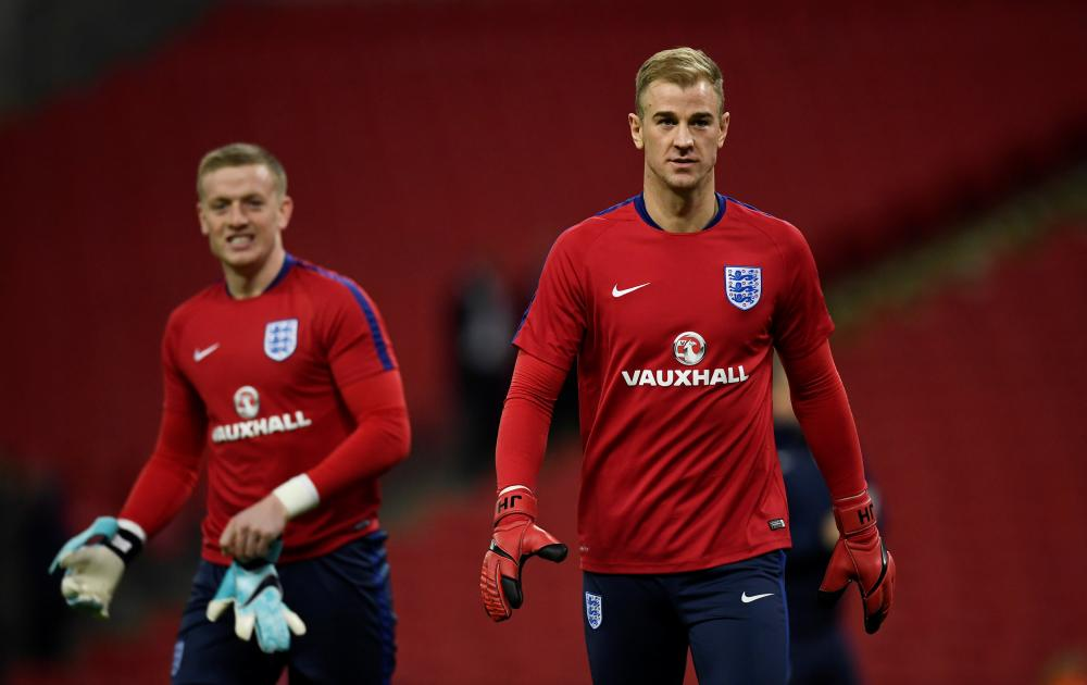 Jordan Pickford and Joe Hart warm up.