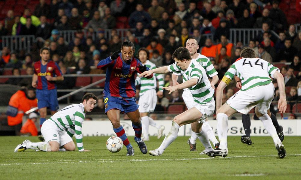 Ronaldinho surrounded by four Celtic players during a Champions League match in March 2008.