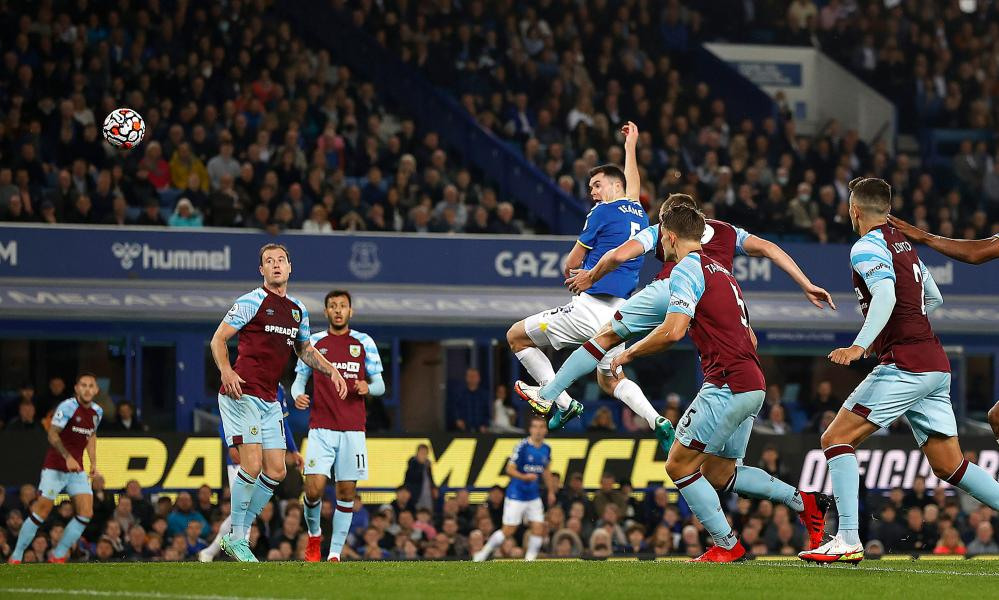 Everton's Michael Keane scores their first goal.