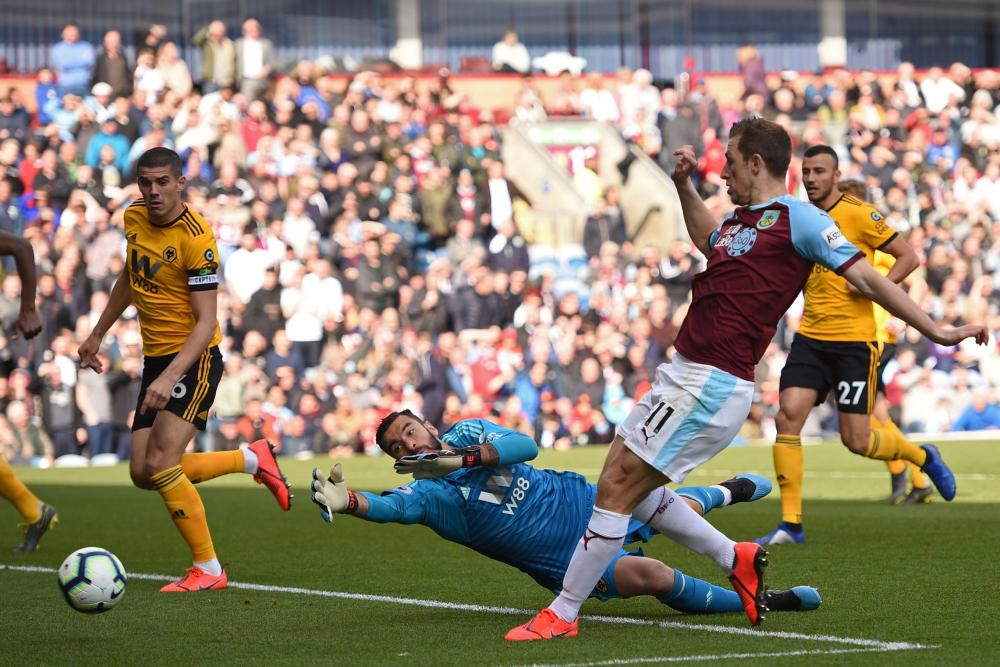 Wolves's Conor Coady prepares to nudge one in for Burnley.
