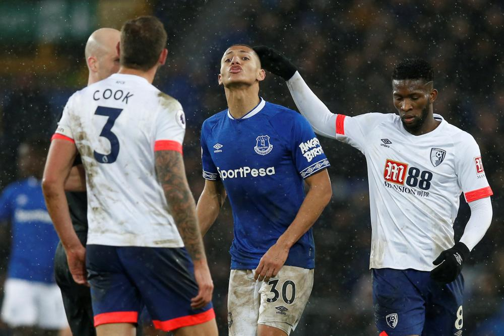 January 13: Everton's Richarlison squares up to Bournemouth's Steve Cook.