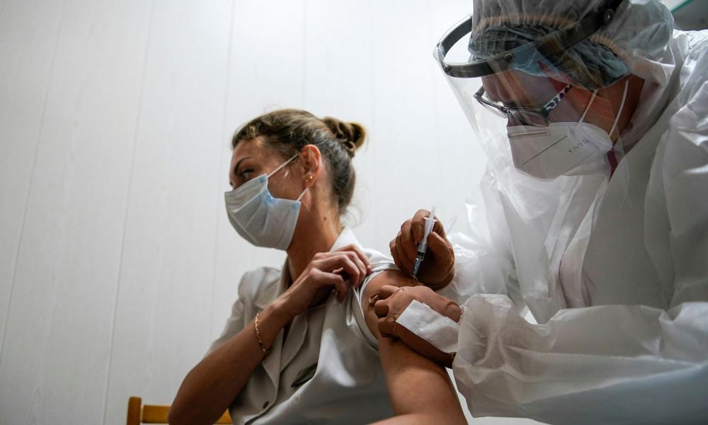 "A medic at a regional hospital receives Russia's ""Sputnik-V"" vaccine shot against the coronavirus disease (COVID-19) in Tver."