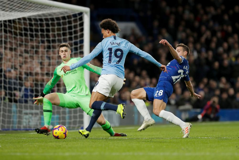 Leroy Sane is denied by Kepa.