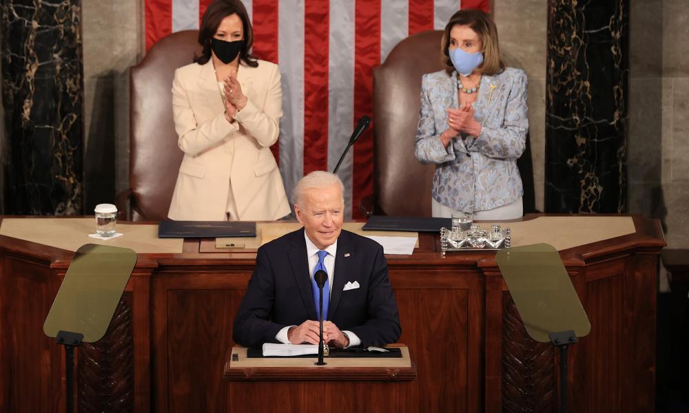 Biden takes the podium