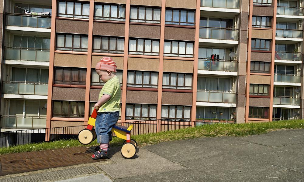 A boy playing in Whitehawk housing estate, Brighton.