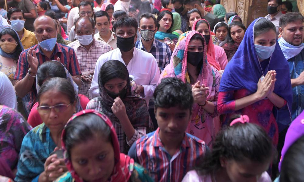 Hindu devotees offer prayers during 'Navratri' at the Mata Longa Wali Devi temple in Amritsar.