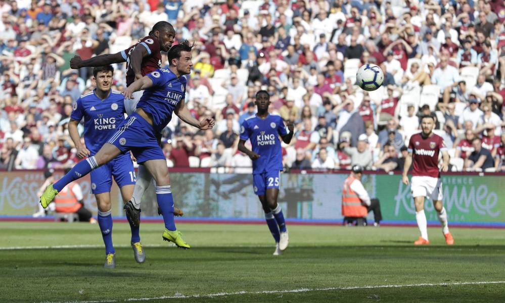 West Ham's Michail Antonio heads the ball into the net to open the scoring.