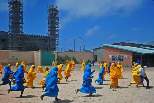 Schoolgirls play football during lunch break at the Howlwadag primary school, south of Mogadishu