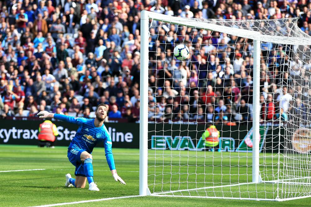 September 29: David De Gea of Manchester United watches the ball as a shot by Andriy Yarmolenko of West Ham United is deflected into the net.