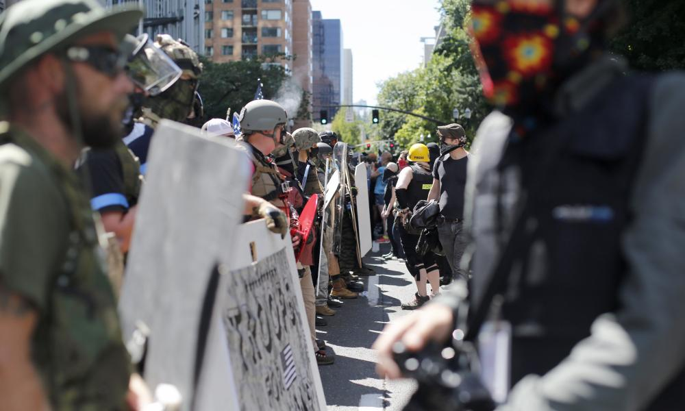 Rightwing and leftwing protesters battle with mace, paint balls and rocks near Justice Center in downtown Portland Saturday, 22 August 2020.