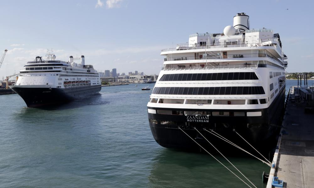 Carnival's Holland America cruise ship Rotterdam, left, arrives at Port Everglades as the Zaandam, right, is docked in Florida.