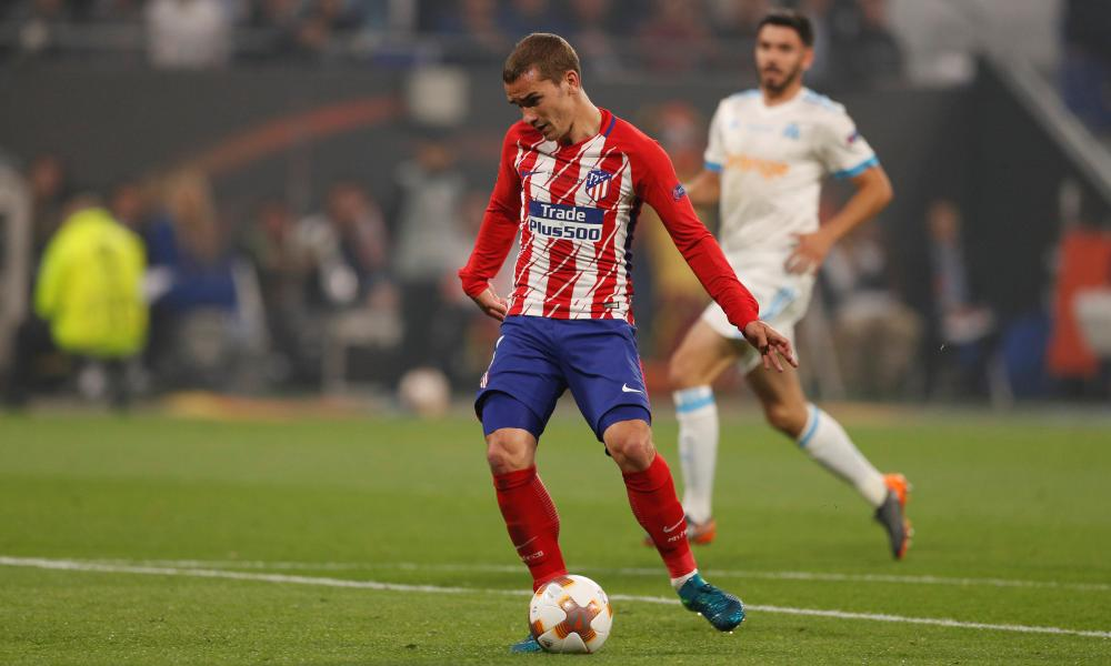 Antoine Griezmann slots the ball home to give Atletico Madrid the lead.