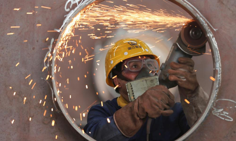 An employee works on a production line manufacturing steel structures at a factory in Huzhou, Zhejiang province, China 17 May 2020.