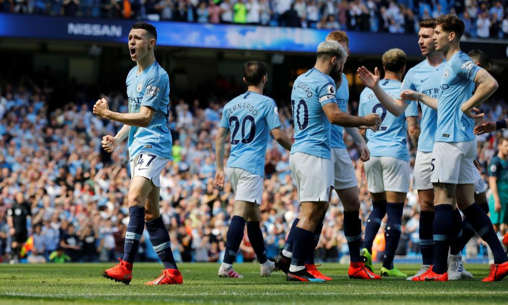 Manchester City's Phil Foden celebrates scoring their first goal.