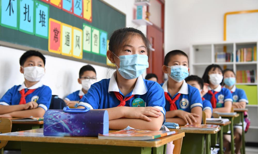 Fourth-graders attend a class at Yangfangdian central primary school in Haidian District of Beijing.