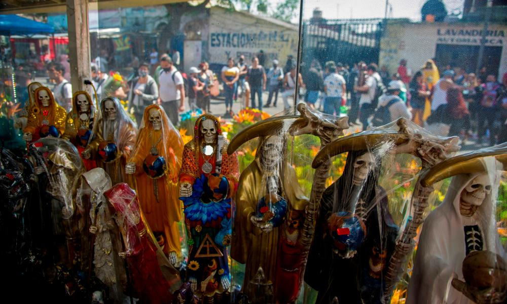 View of figures of Saint Death displayed for sale near its shrine on Alfareria street, in the Tepito neighborhood of Mexico City, October 2020.