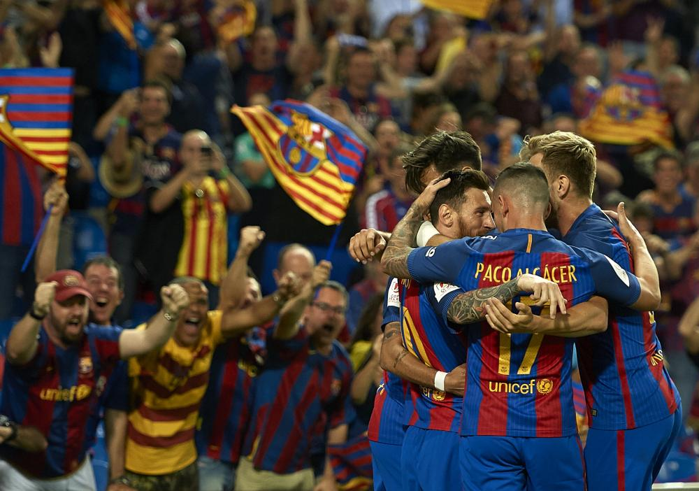 Lionel Messi celebrates scoring his team's first goal in the Copa Del Rey final against Alavés.