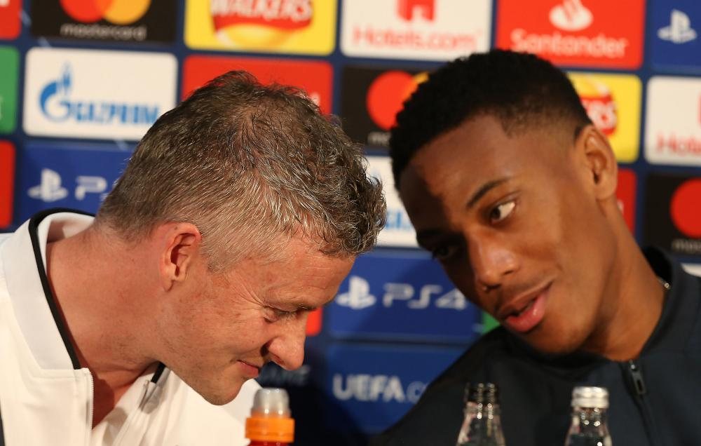 Ole Gunnar Solskjær and Anthony Martial of Manchester United during a press conference on Monday.