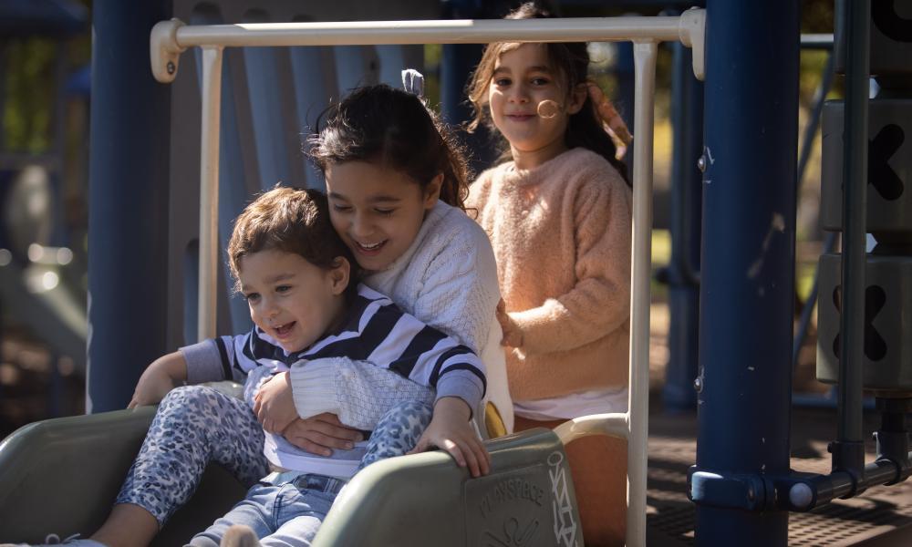 Yasmin, 7, Sophia, 4, and Jacob, 2, at their local park.