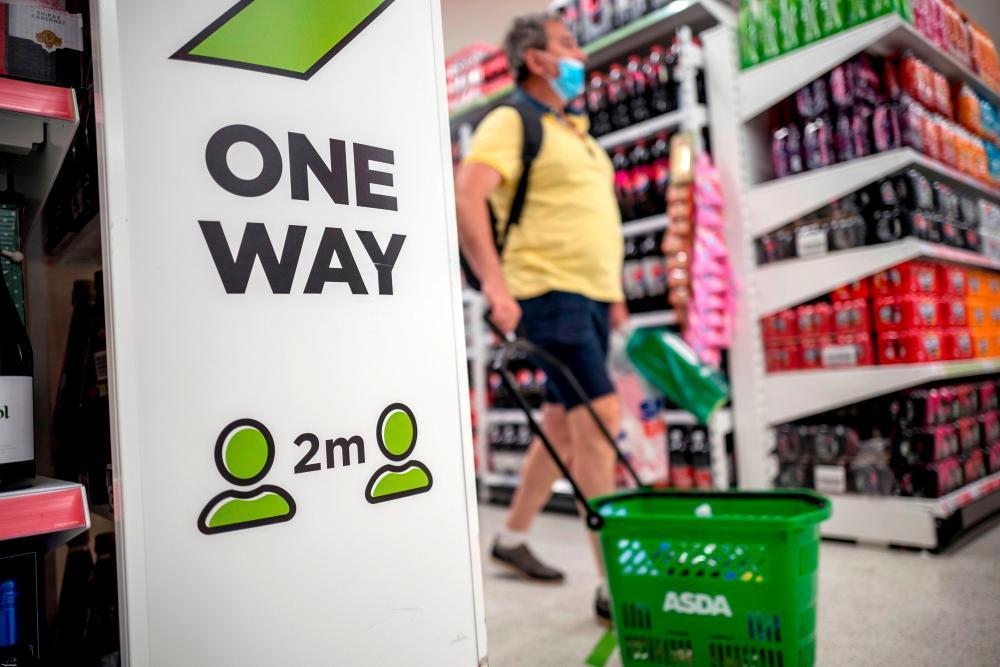 A shopper inside an Asda supermarket store in Walthamstow, east London.