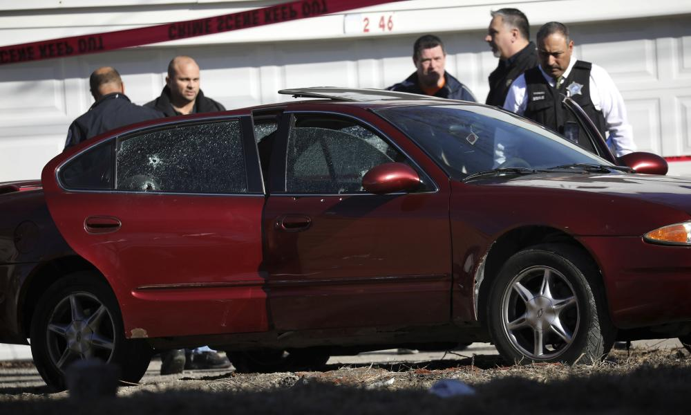 Chicago police investigate the scene of a fatal shooting near Ogden and Kostner avenues in the Lawndale neighborhood of Chicago, in February.