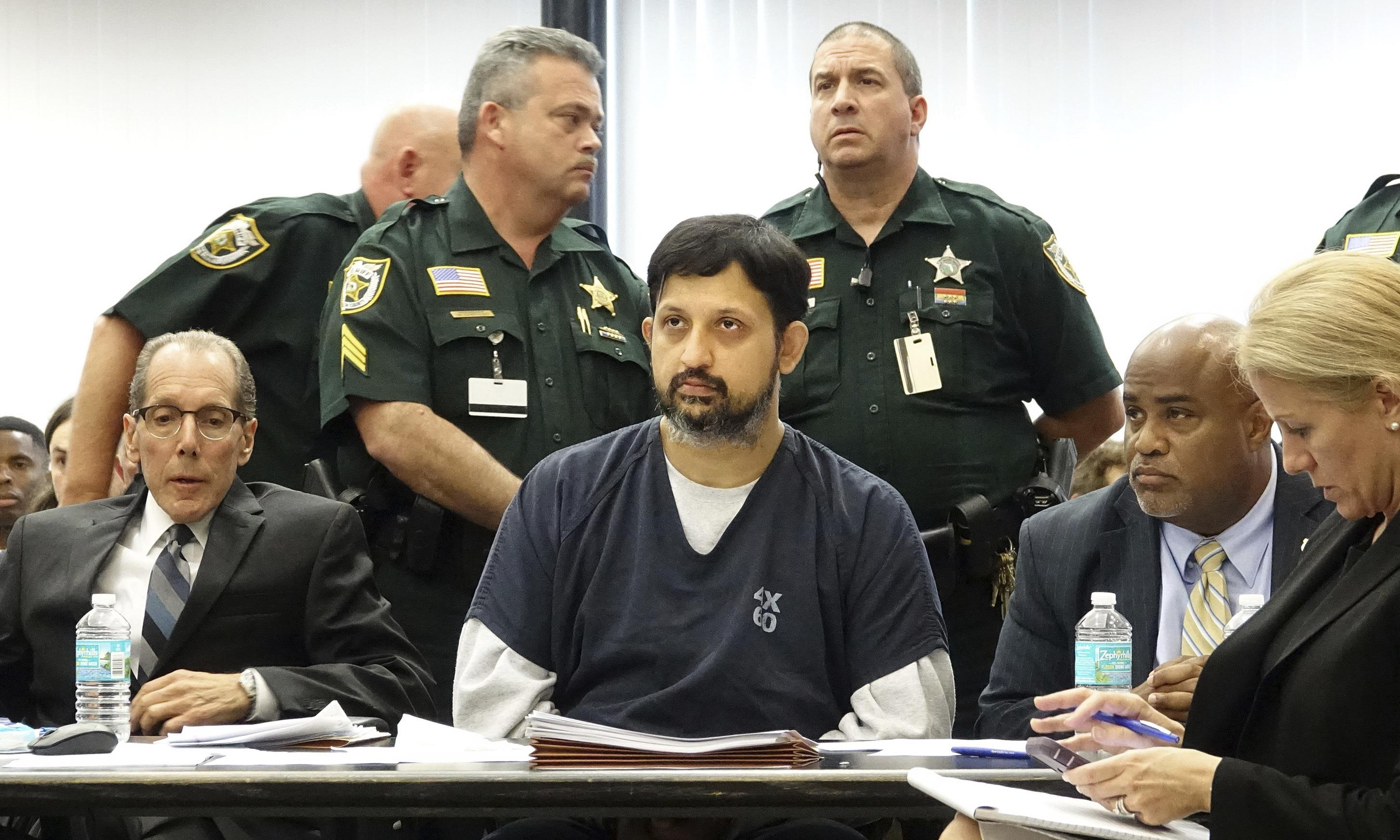 In rare sentencing, ex-Florida officer gets 25 years for killing musician