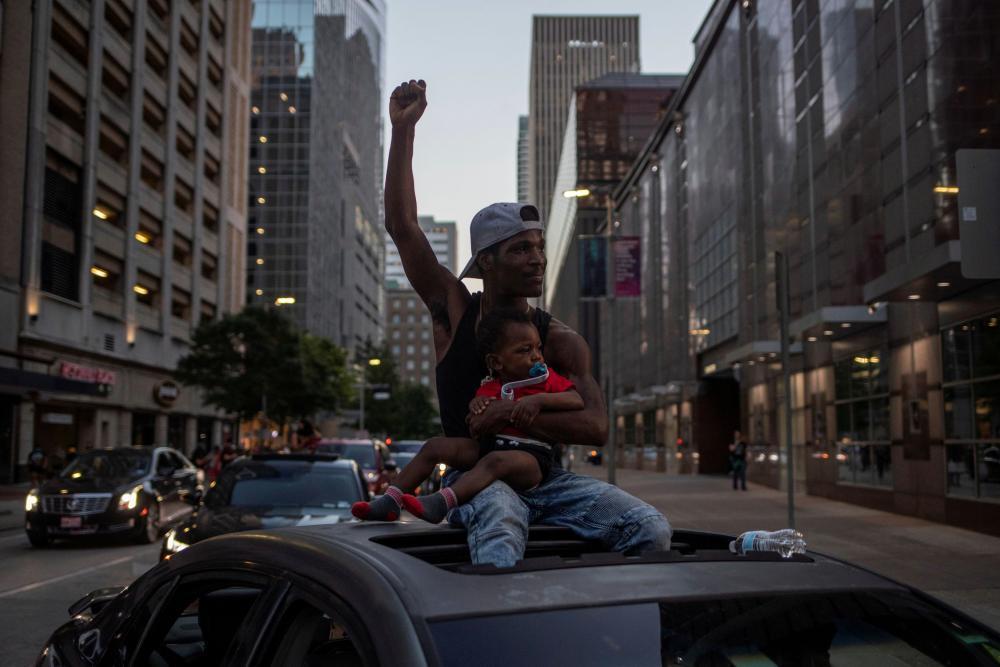 In Houston, a man protests against the death of George Floyd in Minneapolis police custody last week.