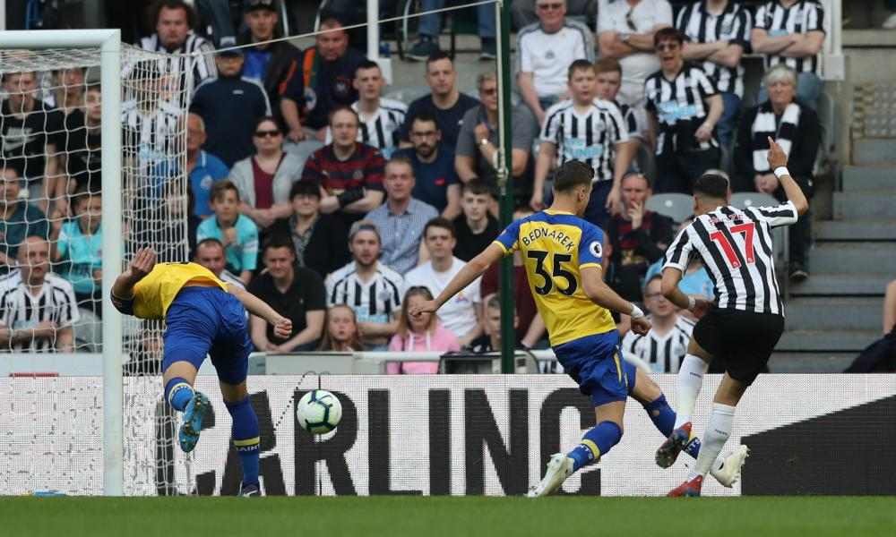 Newcastle United's Ayoze Perez scores their first goal.