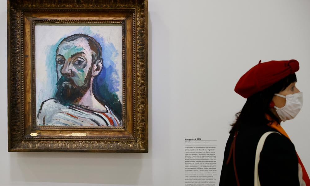 A visitor walks by a work of art titled 'Self Portrait' by Henri Matisse, displayed as part of a retrospective exhibition entitled 'Matisse, like a novel' at he Pompidou Centre in Paris in October