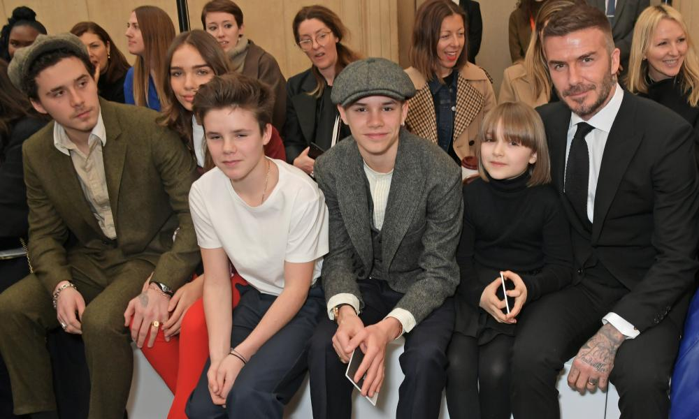 David Beckham with his children attending London fashion week in February 2019