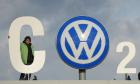 Greenpeace activists on the gate of the  Volkswagen (VW) plant  in Wolfsburg stage a protest using the company logo as part of their slogan: 'CO 2' The problem', in Wolfsburg, Germany, 09 November 2015.