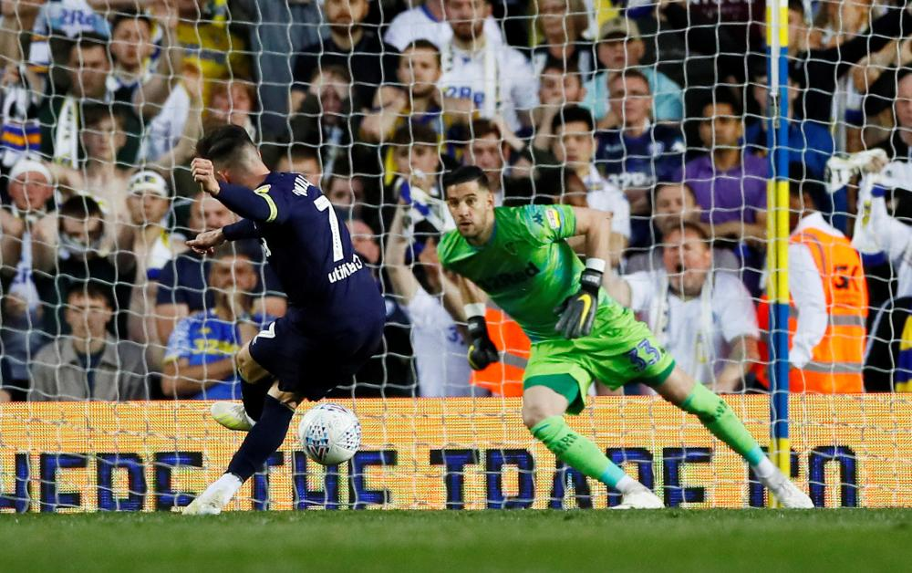 Wilson slots home from the penalty spot for Derby's third.