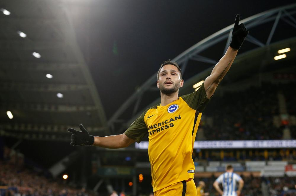 Florin Andone celebrates after putting Brighton ahead.