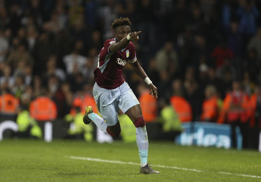 Tammy Abraham of Aston Villa celebrates scoring the winning penalty.
