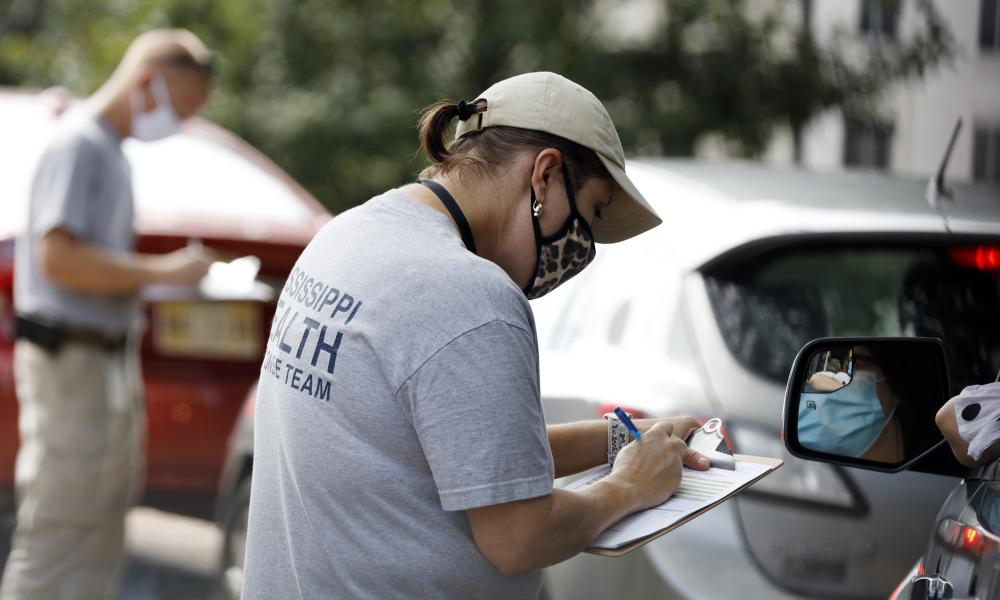 Members of the Mississippi Health Response Team take down medical information from people potentially affected by coronavirus at the Mississippi Legislature at the Capitol in Jackson on Monday, 6 July 2020.