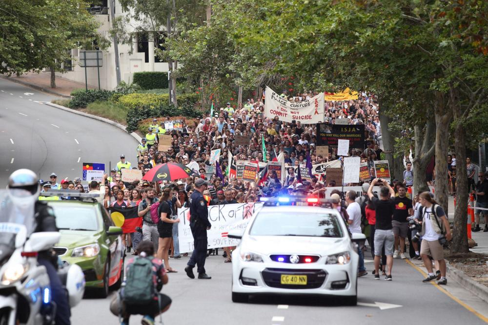 The march heads out of Redfern towards the city