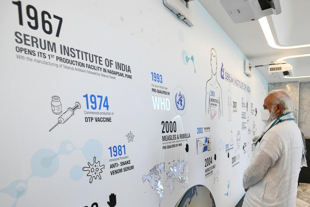 Narendra Modi visits the Serum Institute of India to review the Covid-19 coronavirus vaccine development.