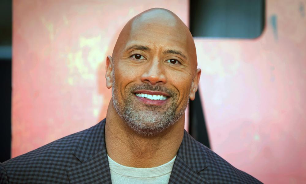 """Dwayne """"the Rock"""" Johnson hosted a globally broadcast concert calling on world leaders to make coronavirus tests and treatment available and equitable for all. (Photo by Vianney Le Caer/Invision/AP, File)"""