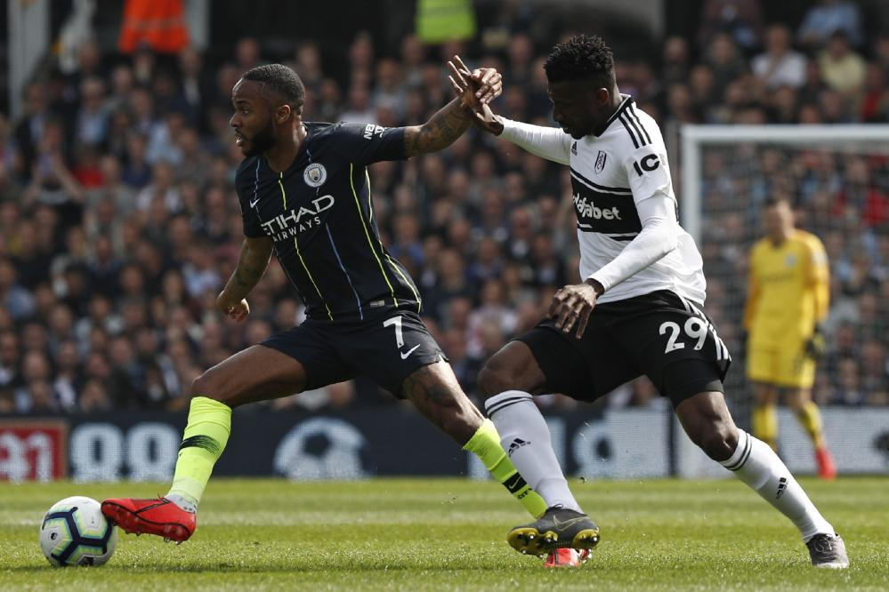 Manchester City's Raheem Sterling goes past Fulham's Andre-Frank Zambo Anguissa.