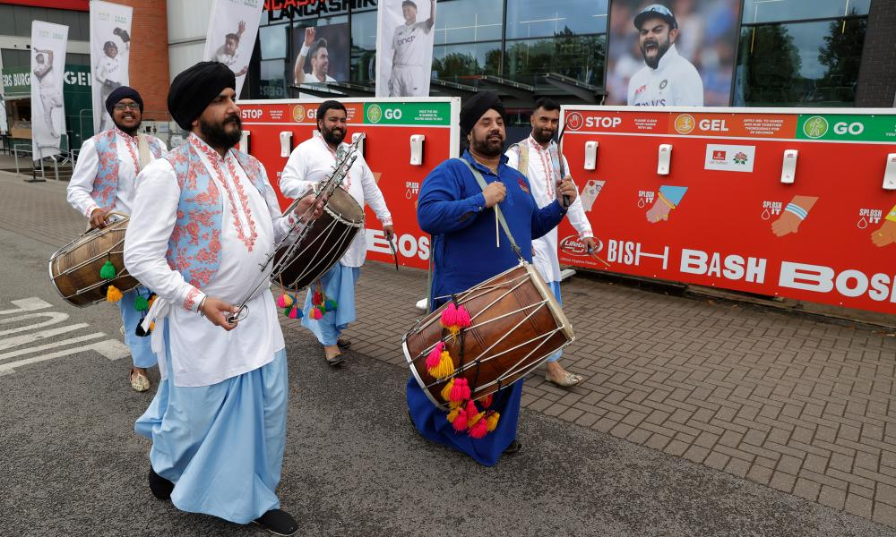 India fans try to put a brave face on things outside Old Trafford.