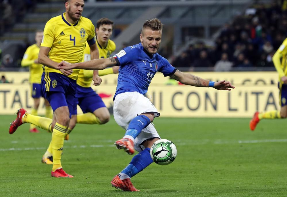Ciro Immobile's shot is deflected off Olsen and is cleared of the line by Lindelof..