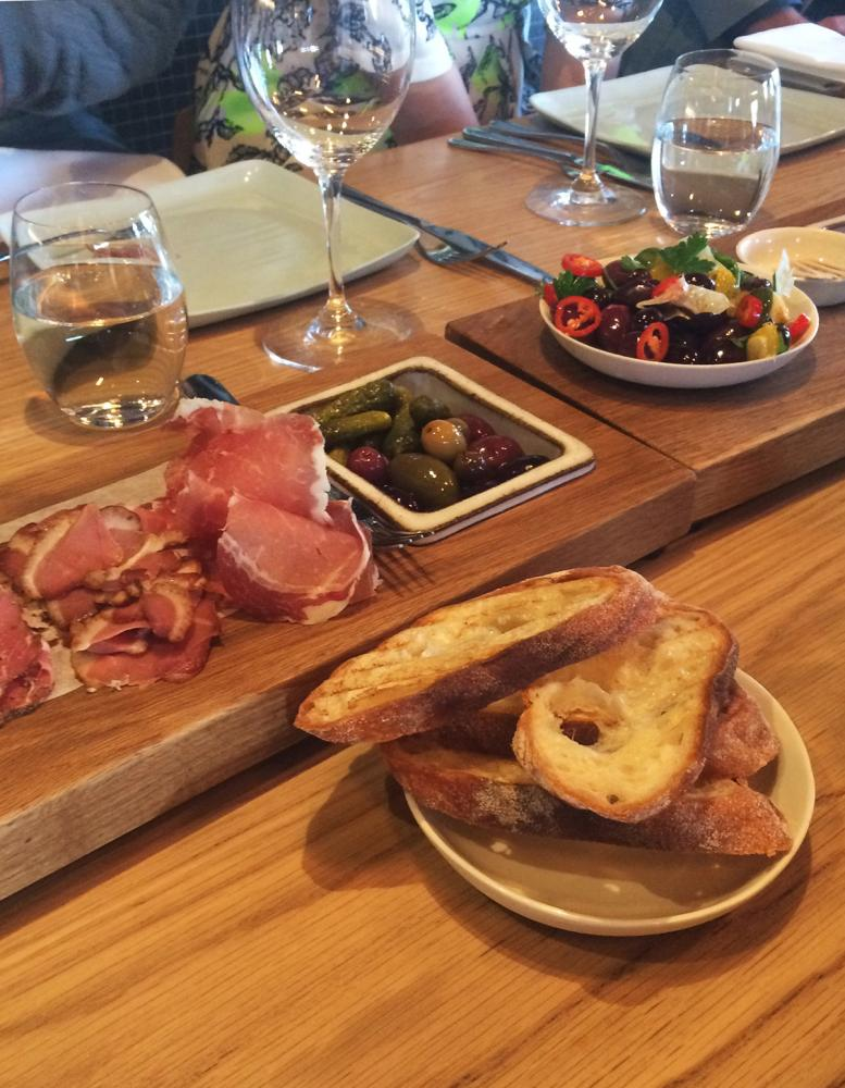 Charcuterie, olives and bread at 2KW restaurant in Adelaide.