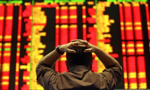 An investor reacts as he monitors the share index at a private stock market gallery in Kuala Lumpur on September 18, 2008.