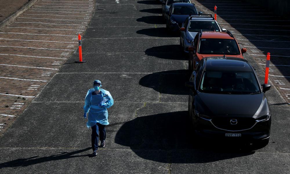 A nurse makes her way towards a Covid-19 testing zone in Sydney, Australia.
