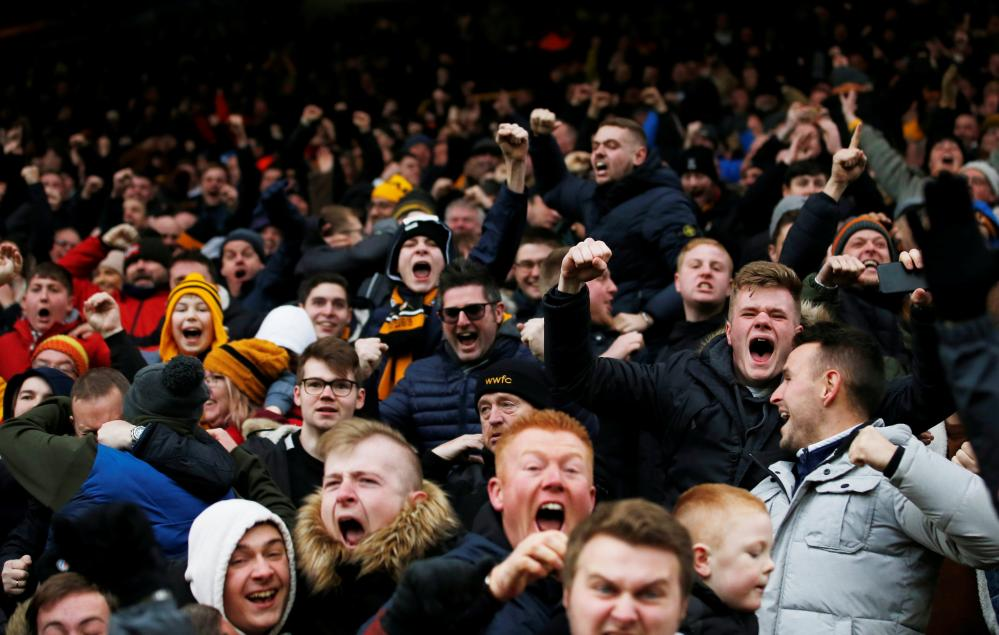 January 19: Wolverhampton Wanderers fans celebrate after Diogo Jota scored their fourth goal against Leicester.