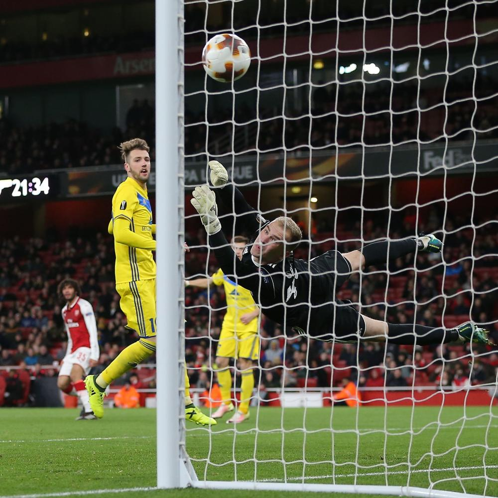 Mohamed Elneny shoots the ball past Bate keeper Denis Shcherbitski for Arsenal's sixth.
