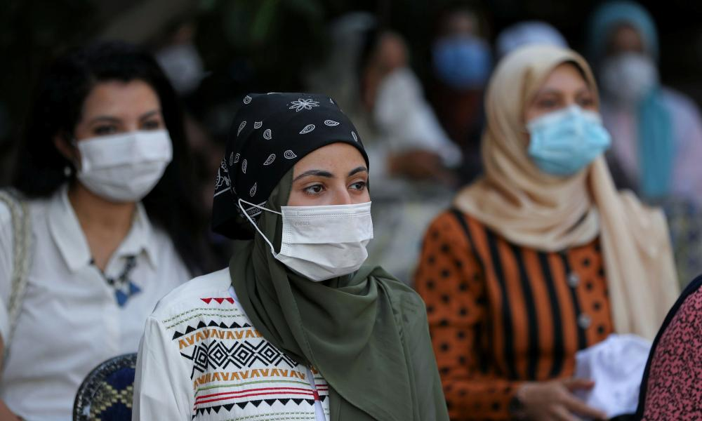 People wait before receiving the vaccine against coronavirus at a mass immunisation venue inside Cairo University, in Cairo, Egypt.