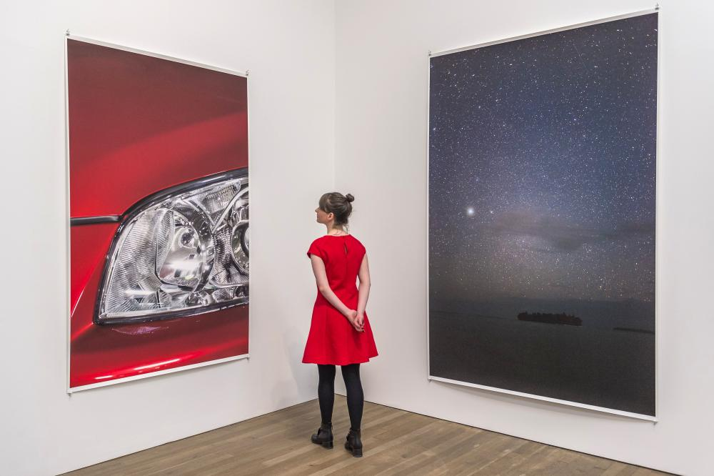 Headlight 2012, left, and Munuwata sky 2011 by Wolfgang Tillmans.